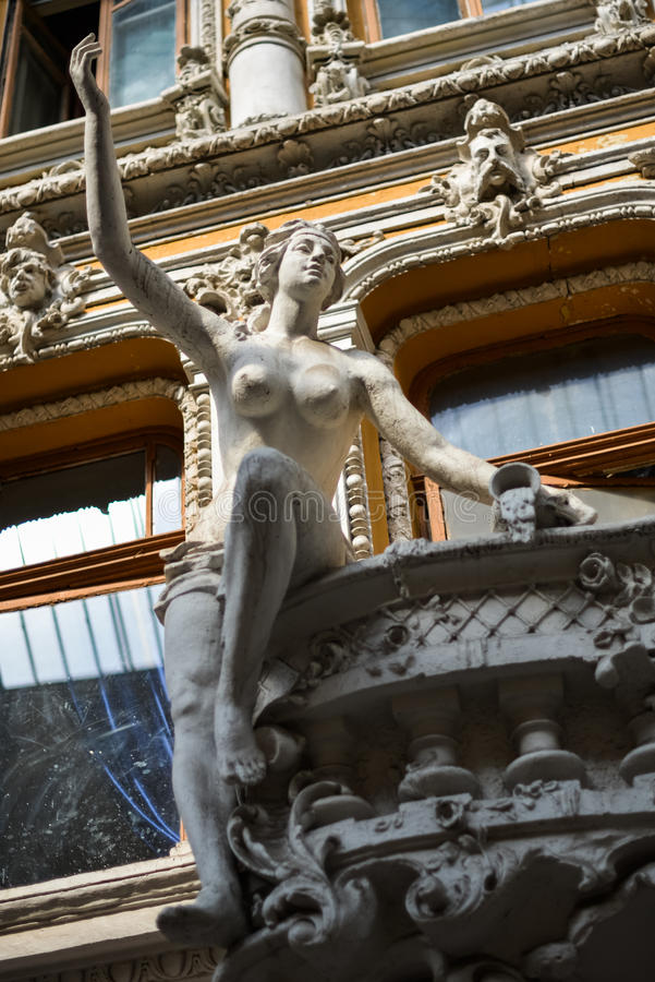 Old sculptures on the balcony of Odessa passage royalty free stock photo