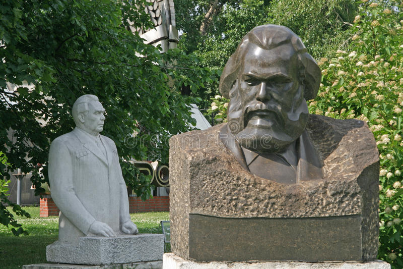 Old sculptures of Karl Marx and Leonid Brezhnev in Muzeon Art Park (Fallen Monument Park) in Moscow royalty free stock photography