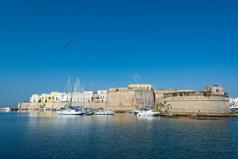 Old sea port of Gallipoli, Apulia, Italy, famous vacation destination with beatiful white sand beaches stock image