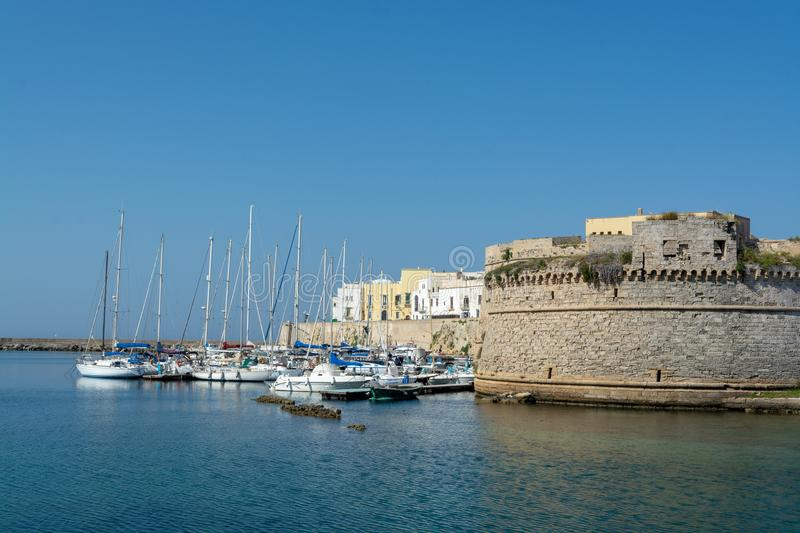 Old sea port of Gallipoli, Apulia, Italy, famous vacation destination with beatiful white sand beaches royalty free stock photography