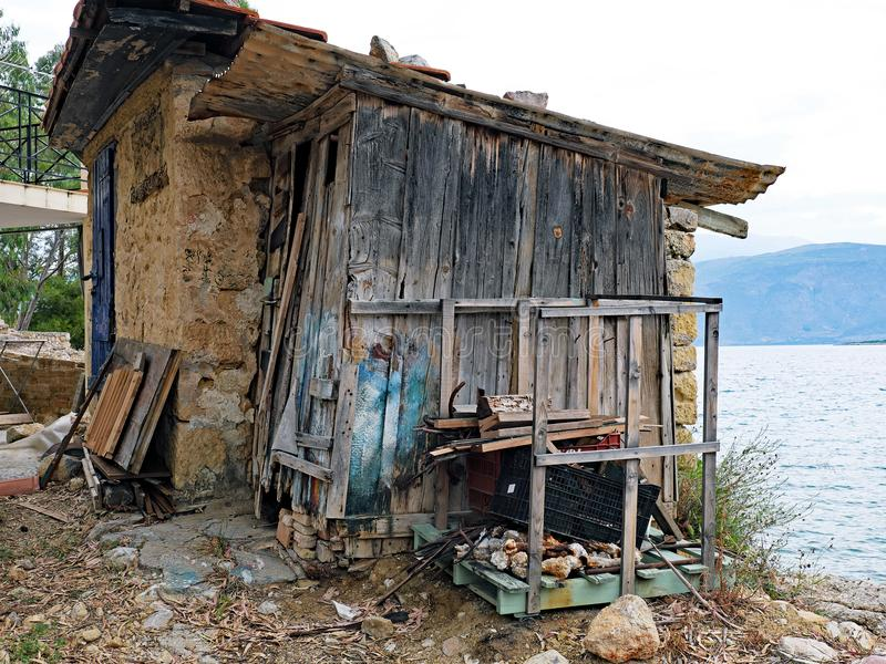 Seaside Shack, Stone, Mud and Old Wood, Greece royalty free stock photos