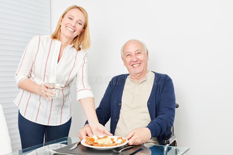 Senior is hungry and happy about his food stock photos