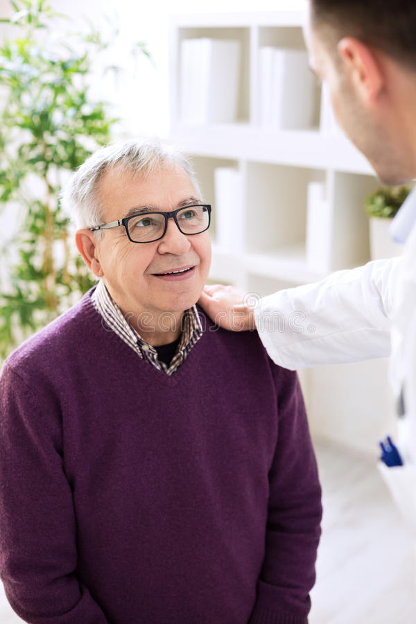 Old senior patient visit doctor royalty free stock image