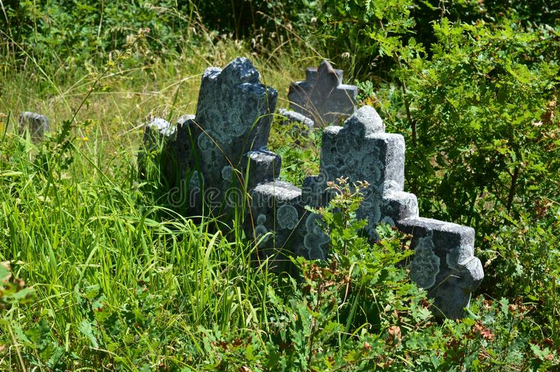 Serbian Orthodox stone tombstones. Old Serbian Orthodox stone tombstones stock photo