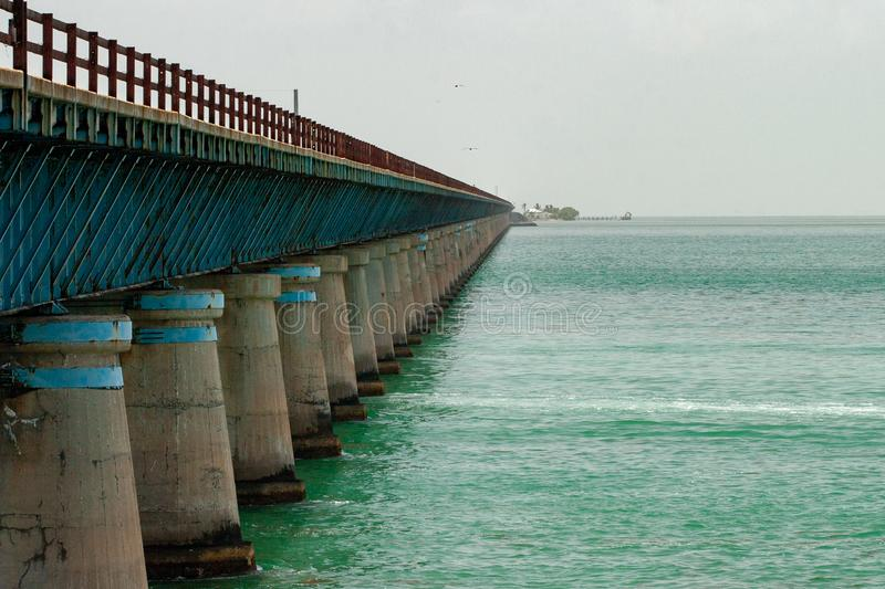 Old Seven Mile Bridge as on heads south. Old Seven Mile Bridge in Florida Keys used for walking and fishing with Little Duck Key in the distance as one heads stock photo