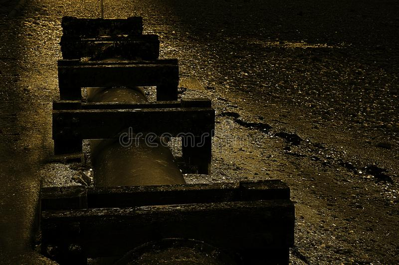 Old sewage pipe on the Uk beach royalty free stock photo