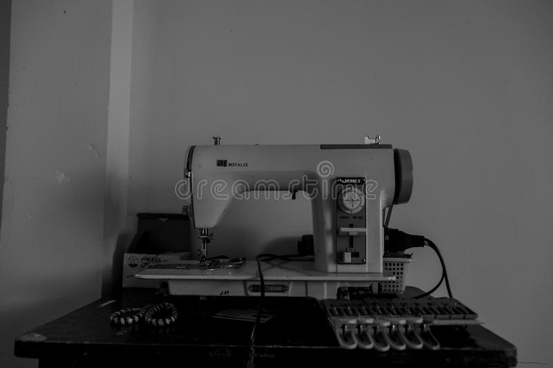 Old sewing machine. Because of sewing machines, clothes could be produced more cheaply, and new synthetic dyes offered a much greater choice of colors royalty free stock images