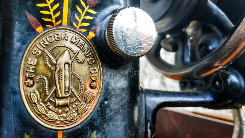 Old sewing machine vintage retro close up. Singer Factory Emblem royalty free stock images