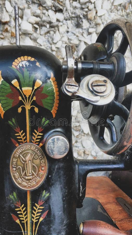 Old sewing machine vintage retro close up. Singer Factory Emblem royalty free stock image