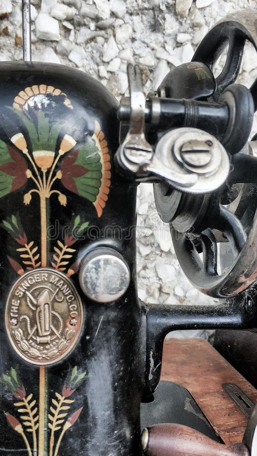 Old sewing machine vintage retro close up. Singer Factory Emblem royalty free stock photography