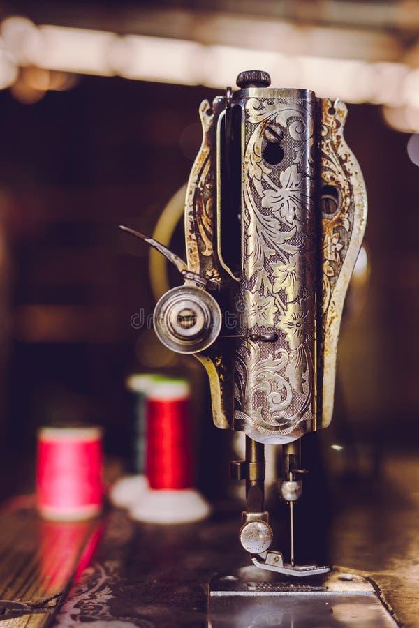 Old sewing machine, vintage tone royalty free stock image
