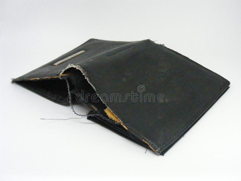 Old shabby empty wallet. Isolated stock photography