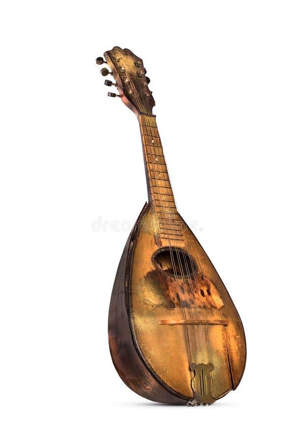 Old shabby mandolin. Antique old-fashioned obsolete mandolin on white background royalty free stock image