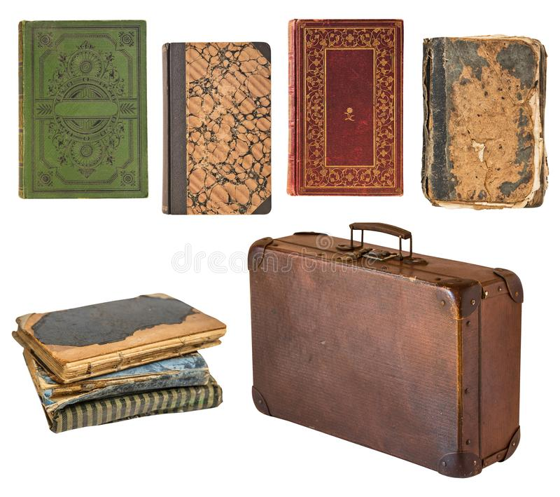 Old shabby vintage suitcase and books isolated on white background. Retro style stock photos