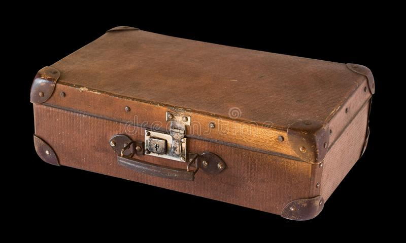 Old shabby vintage suitcase isolated on black background. Retro style royalty free stock images