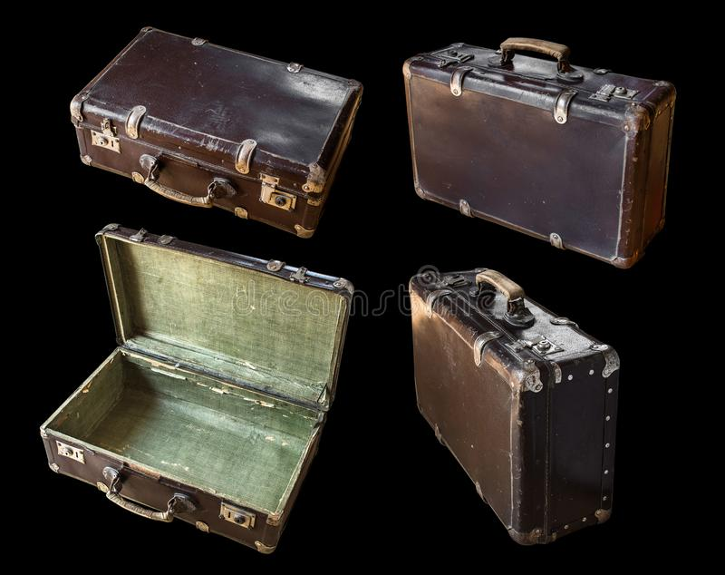 Old shabby vintage suitcase isolated on black background. Retro style royalty free stock photography