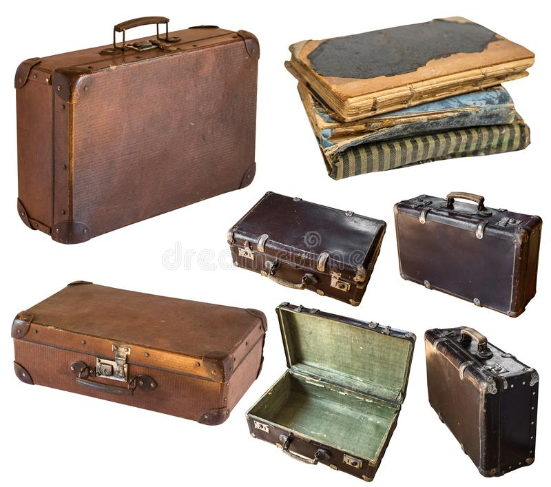 Old shabby vintage suitcases and book isolated on white background. Retro style stock images