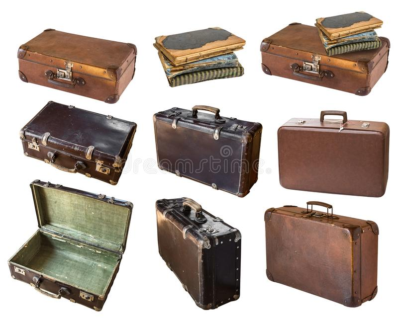 Old shabby vintage suitcases and books isolated on white background. Retro style stock photography