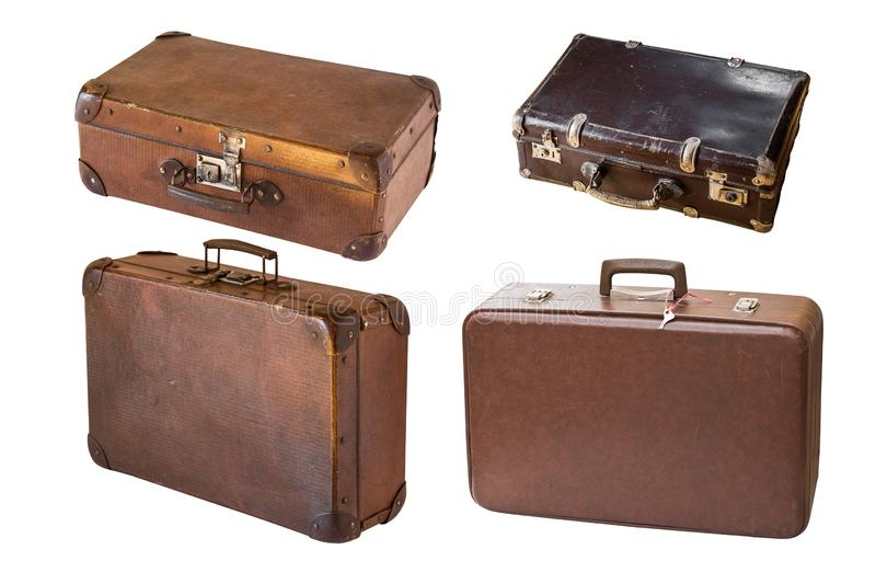Old shabby vintage suitcases isolated on white background. Retro style stock photography