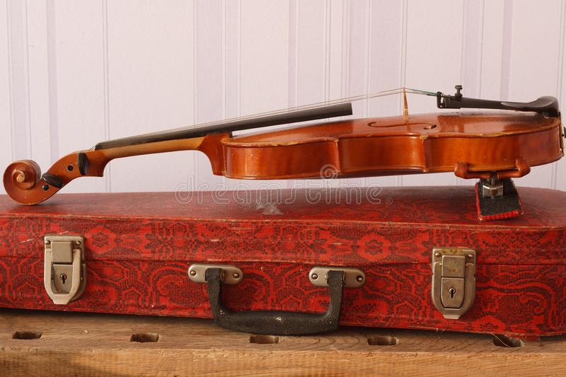 Old shabby violin with case on a table royalty free stock photos