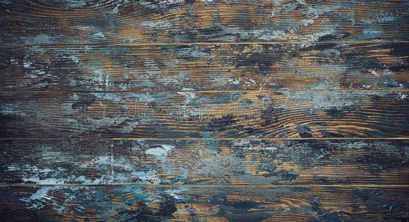 Old shabby wooden boards, background with traces of blue paint, texture of old wood, vintage, rustic, traces of paint, dark blue, royalty free stock photography