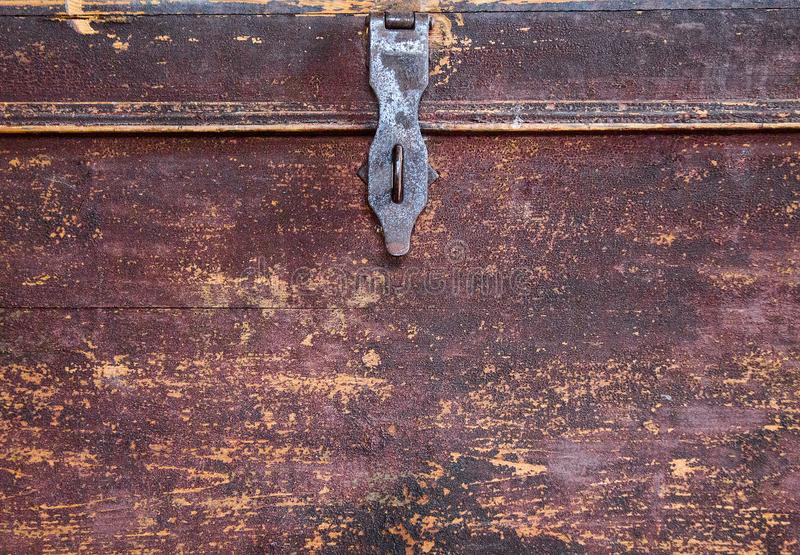 Old and shabby wooden brown chest. Background royalty free stock images