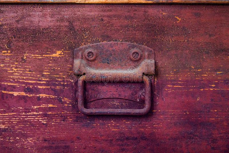 Old and shabby wooden brown chest. Background stock photography