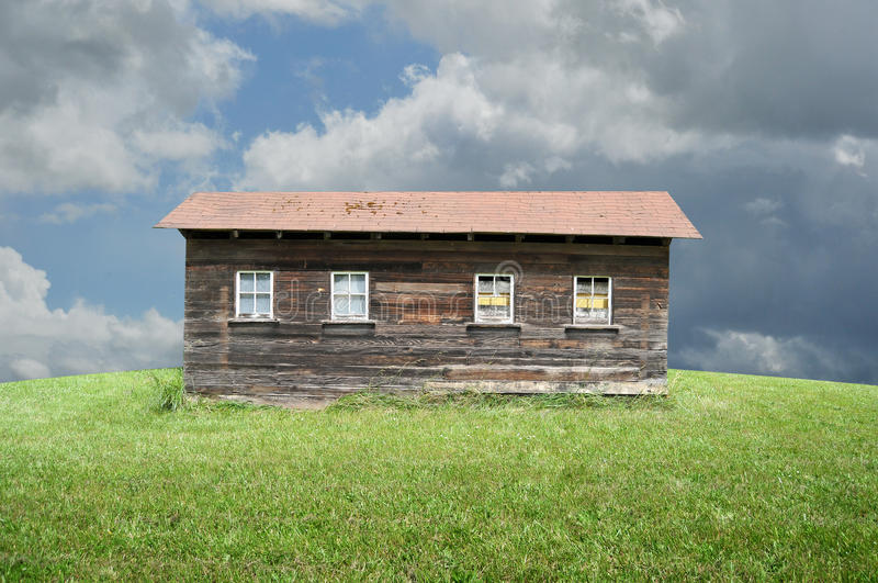 Old Shack. An old shack in a big empty green grass field stock images