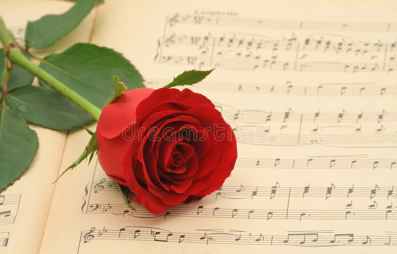 Old sheet music with rose royalty free stock photos