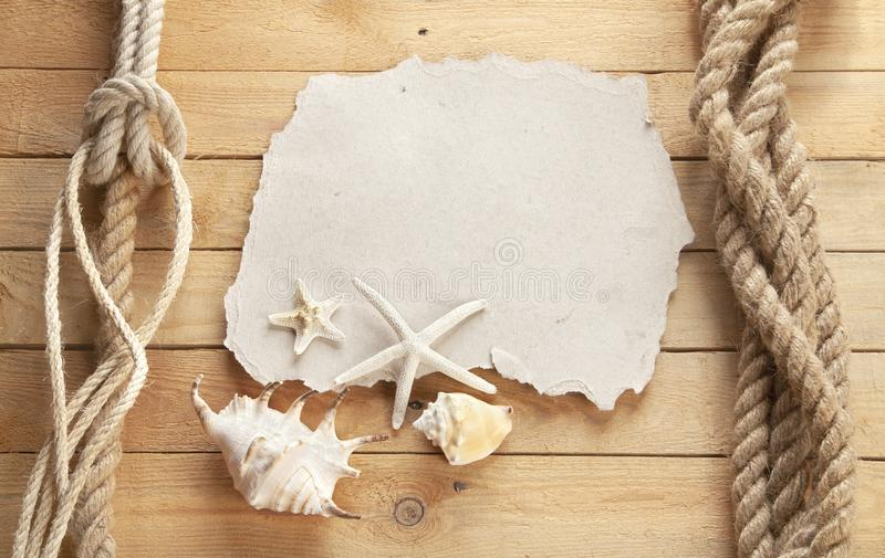 Old sheet of paper on a wooden background. stock photography