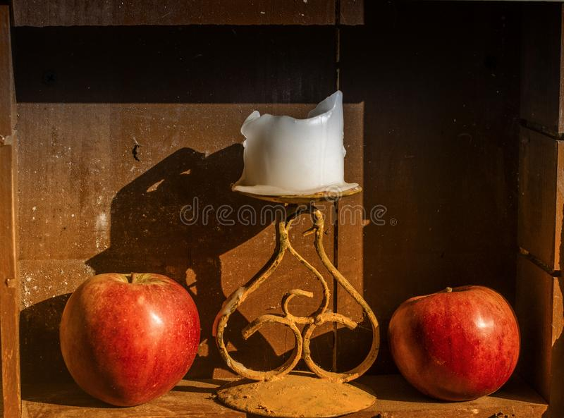 Two red apples and candle royalty free stock photos