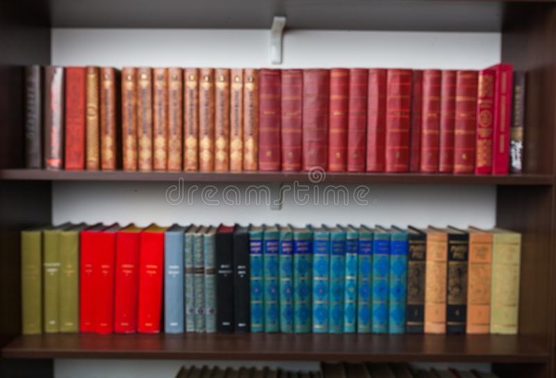 Shelves with old books at home stock images