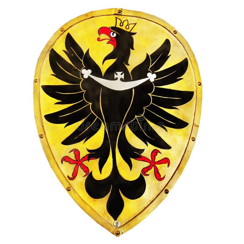 Old Shield Emblem Heraldic Eagle Isolated. Old shield with heraldic eagle emblem isolated on white background royalty free stock image