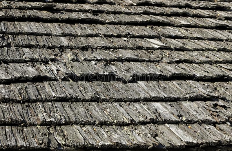 Old shingled roof. Old traditional roof covered with wooden lath shingles, Zakopane in Poland royalty free stock photography
