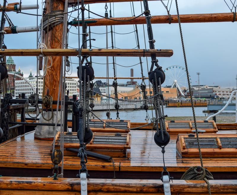 Old Ship Deck. View from the side in the cloudy and rainy day. In the background visible city of Helsinki in Finland royalty free stock image