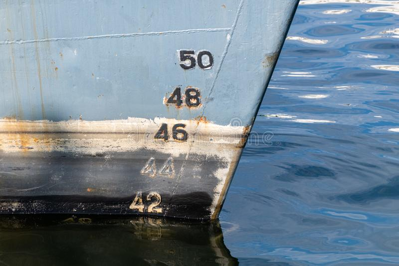 Old ship draft on hull, scale numbering. Distance between waterline and bottom keel stock images