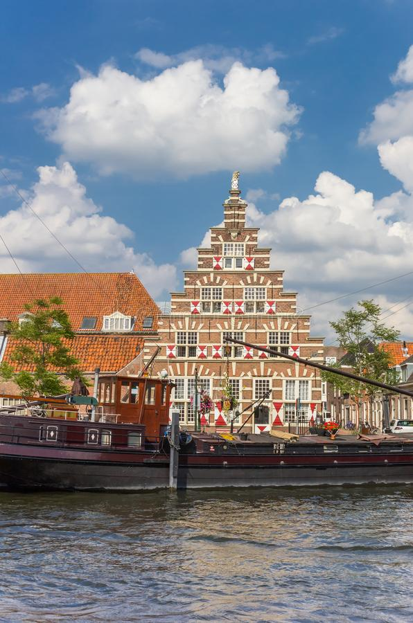 Old ship and historic facade in the center of Leiden stock photo