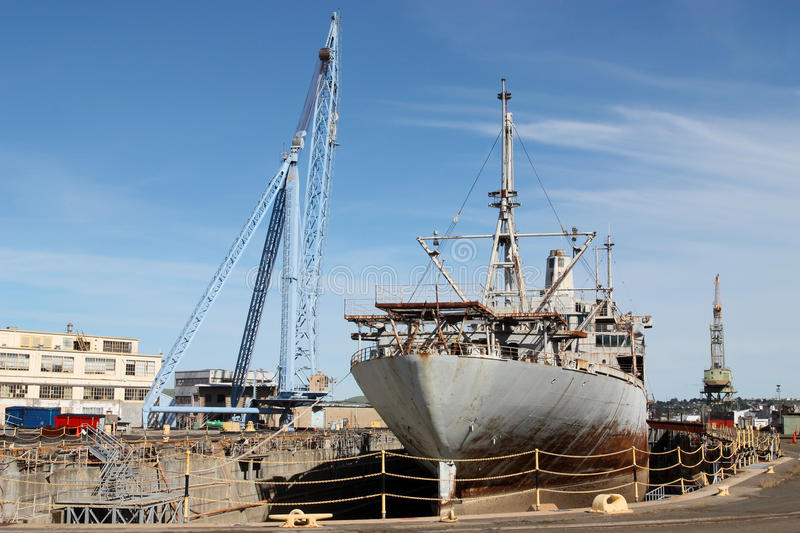 Old Ship. Old rusty ship on dry dock stock photo