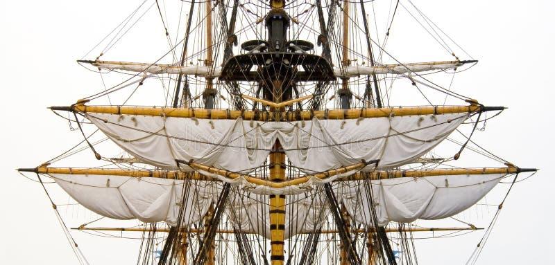 Old ship sails & masts. Kogg masts with ropes and sails royalty free stock image