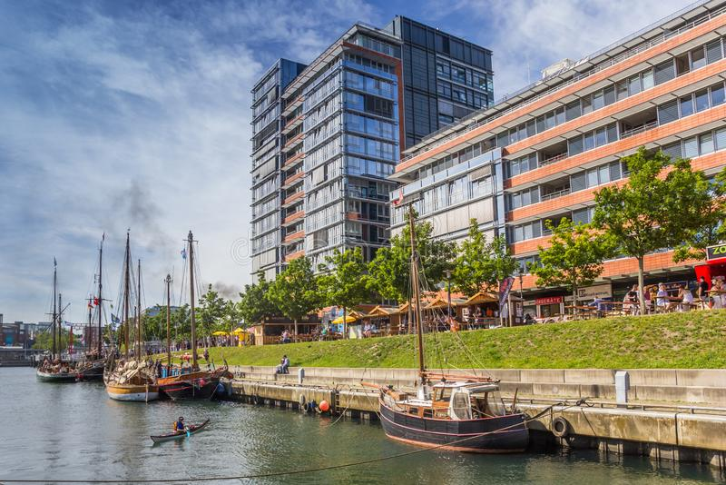 Old ships and modern buildings in the harbor of Kiel royalty free stock photography