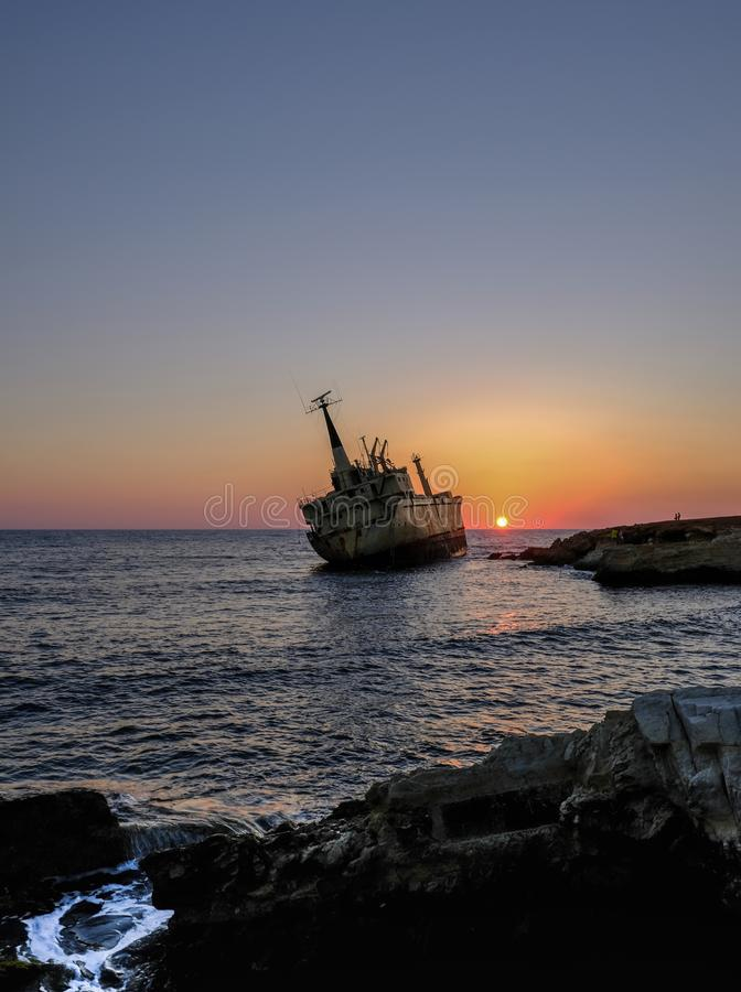 Old shipwreck that has run agound in Pafos,Cyprus. An autumn shot with the sun just about to go below the horizon stock photography