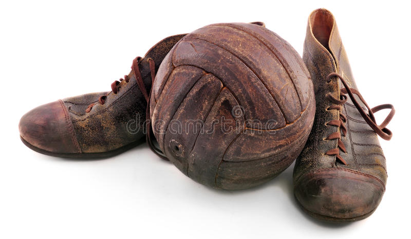 Old shoes for soccer and soccer ball royalty free stock photography