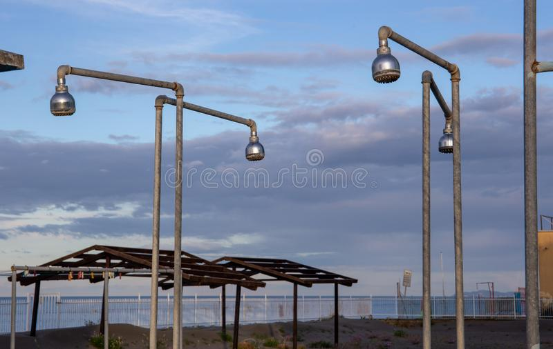 Old showers in the garden of an adandoned beach house in the riviera romagnola area, near Rimini and Riccione.  royalty free stock photos