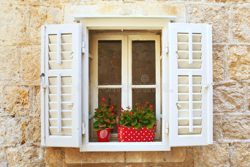 Download Old Shutter Windows With A Flowers. Croatia. Stock Image - Image: 21022415