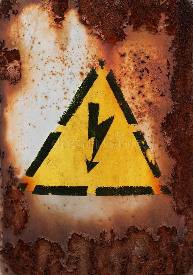Old sign of danger of electric shock covered with rust.  royalty free stock images