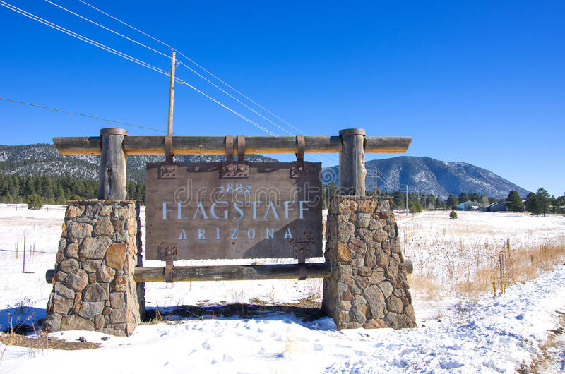 Old sign of Flagstaff,Arizona. Flagstaff sign with snow,Arizona royalty free stock photos