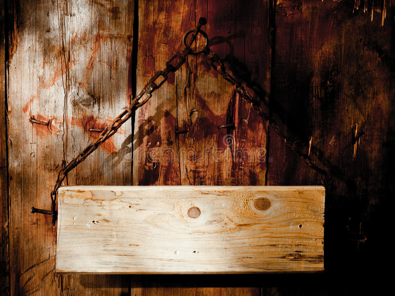 Old Signboard. Board, hanging on chain stock image