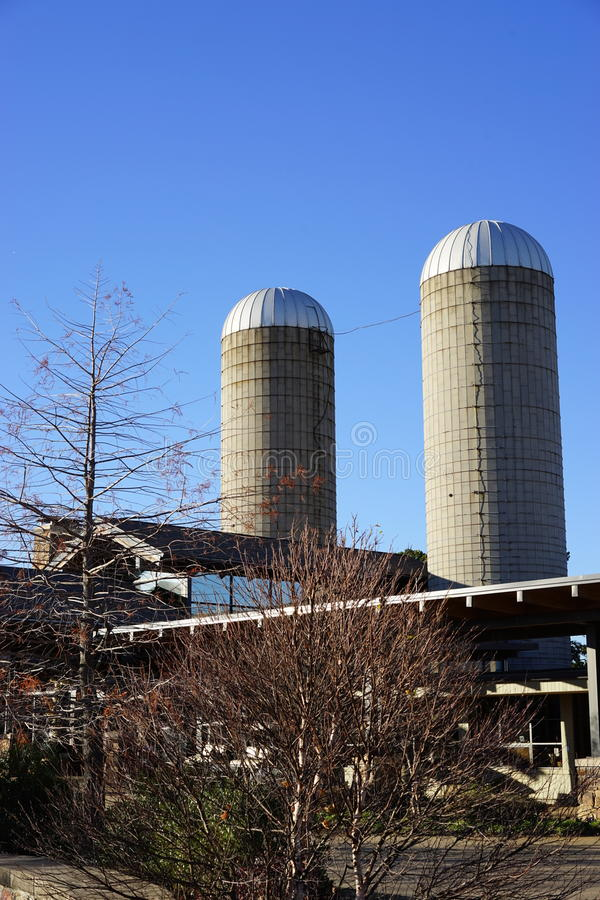 Old silos meet new agricultural technology. Two vintage silos provide a strong contrast between traditional farming methods and modern technology. The Winthrop P stock photo