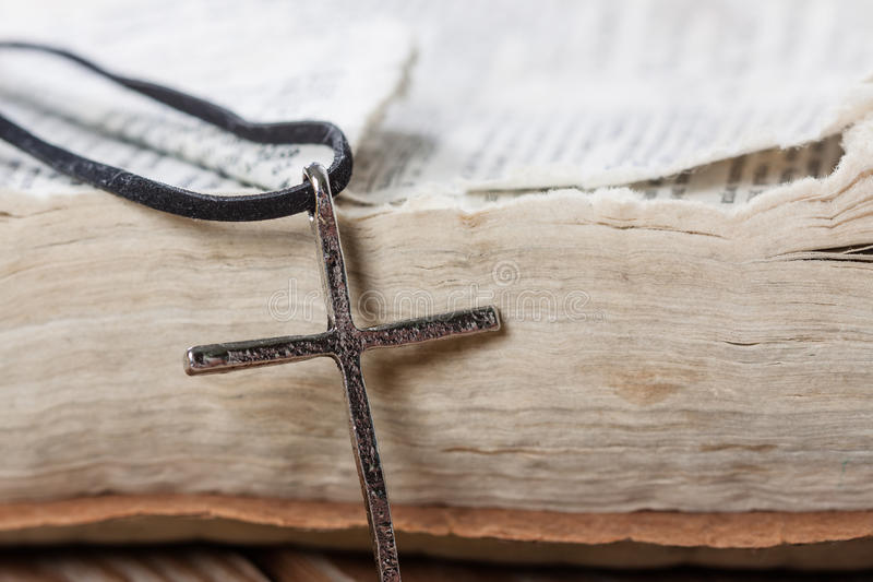 Old silver christian cross on bible stock images