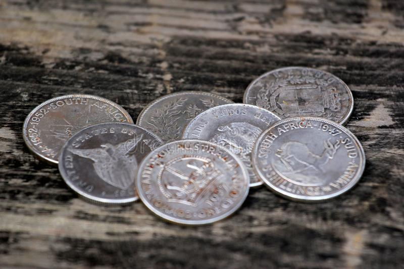 Old silver coins as souvenirs on wooden table stock images